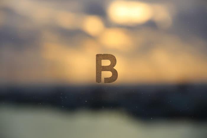 Breakwater B Logo in glass in Akoya Suite